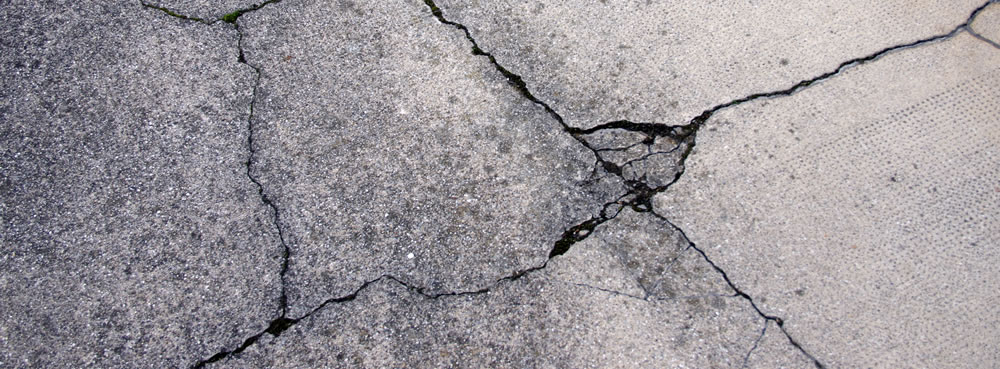 Cracked and Damaged Asphalt in need of repair