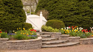 stackable stone retaining wall and stone stairs